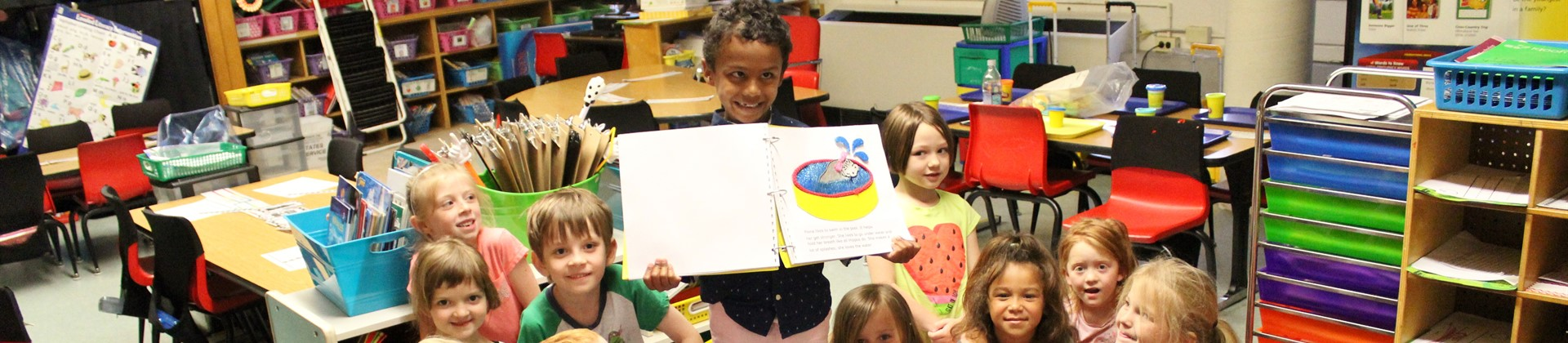 "Tai read ""Fiona, the Baby Hippo,"" a book written in braille, to our kindergarten class!"